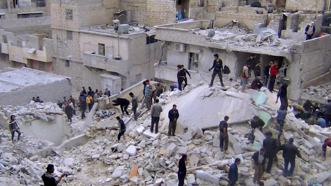 In this citizen journalism image taken on Wednesday, March 20, 2013 provided by Aleppo Media Center AMC which has been authenticated based on its contents and other AP reporting, Syrian citizens search for dead bodies on the rubble of damaged buildings that were attacked by Syrian forces airstrikes, at al-Zarazir neighborhood, in Aleppo, Syria. Syrian rebels captured one village and parts of others on the edge of the Golan Heights Thursday as fighting closed in on the strategic plateau that Israel captured from Syria in 1967 and later annexed, activists and officials said.(AP Photo/Aleppo Media Center, AMC)