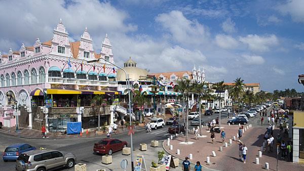 1. Aruba Highest income tax rate: 58.95%  Average 2010 income: N/A   Aruba, a Dutch territory, has the highest income tax rate in the world. It is also the only country in the Americas to make the top 10 list.   The tax rate used to be as high as 60 percent before 2007. The current top marginal rate of 59 percent kicks in at around $165,000. Married individuals have a lower maximum rate of 55.85 percent, compared with single taxpayers at 58.95 percent. Other notable taxes include a capital gains tax of 25 percent, along with health, pension and accident insurance premiums. With an array of social security taxes, Aruba is known to have one of the highest living standards in the Caribbean.   The small island's exceptionally high tax rate is also much higher than the Caribbean average of 26.7 percent. Islands like the Bahamas, Bermuda and Cayman Islands have no personal income taxes. The closest to Aruba in terms of income tax rates are neighboring South American countries Argentina, Colombia, Ecuador, Guatemala and Venezuela, which have maximum tax rates ranging between 31 percent and 40 percent, according to KPMG.   Pictured: Oranjestad, Aruba  Photo: Holger Leue | Getty Images Click here to see the countries with the highest income tax rates.