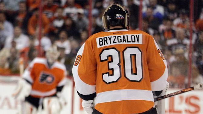 Philadelphia Flyers' goalie Ilya Bryzgalov skates out to the net to replace Sergie Bobrovsky during the second period of an NHL hockey game with the Winnipeg Jets, Thursday, Oct. 27, 2011, in Philadelphia. (AP Photo/Tom Mihalek)