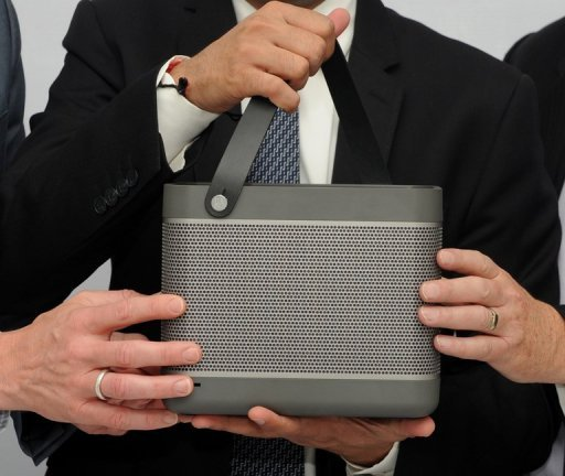 A Bang and Olufsen Beolit 12 portable speaker at a promotion in New Delhi last year. Danish high-end hi-fi maker Bang & Olufsen reported on Wednesday a 47-percent plunge in its second-quarter net profit and announced the closure of 125 stores.