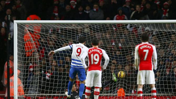 Queens Park Rangers' Charlie Austin shoots to score a penalty against Arsenal during their English Premier League soccer match at the Emirates Stadium in London