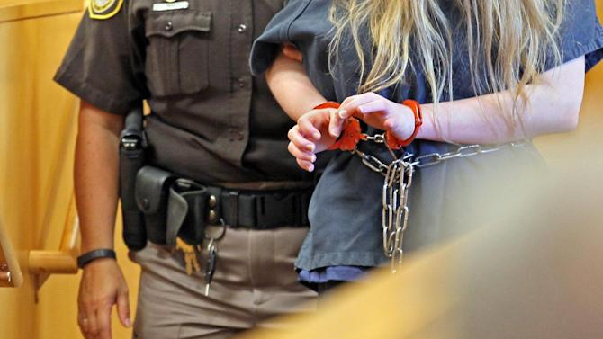 One of the two girls accused of stabbing another girl is led back into the courtroom after a recess at Waukesha County Court in Waukesha, Mich, Friday, Aug. 1, 2014. One of two 12-year-old girls charged as an adult with stabbing a classmate to please a fictional online horror character is mentally incompetent and can't stand trial, a judge said Friday. (AP Photo/Milwaukee Journal-Sentinel, Michael Sears, Pool)
