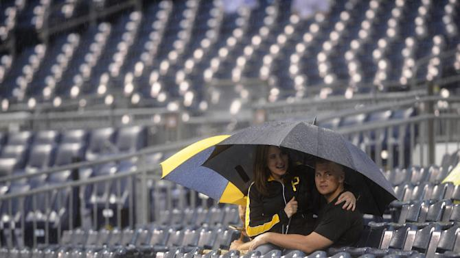 McCutchen helps free grounds crew member swallowed by tarp