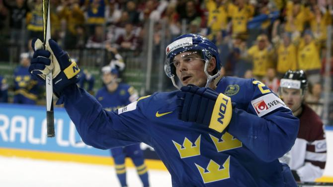 Sweden's Eriksson celebrates his goal against Latvia during their Ice Hockey World Championship game at the O2 arena in Prague