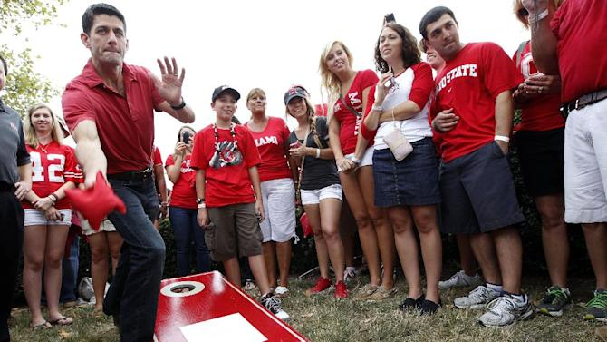 Republican vice presidential candidate, Rep. Paul Ryan, R-Wis., plays cornhole during a tailgate party at the The Ohio State University-Miami University of Ohio football game, Saturday, Sept. 1, 2012,  at Ohio Stadium in Columbus, Ohio.  (AP Photo/Mary Altaffer)
