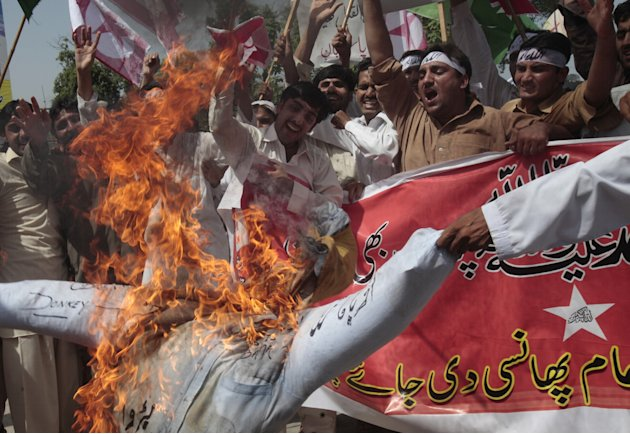 Pakistani protesters burn an effigy of U.S. President Barack Obama during a demonstration that is part of widespread anger across the Muslim world about a film ridiculing Islam's Prophet Muhammad, nea