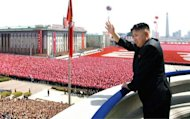North Korean leader Kim Jong-Un waves to the crowd as he reviews a military parade in Pyongyang in April 2012. In a rare and remarkable interview posted on YouTube, the teenage grandson of late North Korean leader Kim Jong-Il has provided a glimpse into the secretive world of his country's ruling dynasty