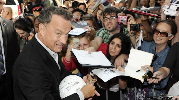 "Actor Tom Hanks signs autographs at the premiere of ""Cloud Atlas"" during the Toronto International Film Festival on Saturday Sept. 8, 2012 in Toronto. (Photo by Evan Agostini/Invision/AP)"