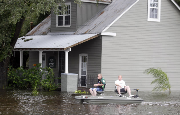 Two men use small boat to travel though flooded streets Thursday, Aug. 30, 2012, in Slidell, La. Isaac&#39;s maximum sustained winds had decreased to 45 mph and the National Hurricane Center said it was expected to become a tropical depression by Thursday night. (AP Photo/John Bazemore)