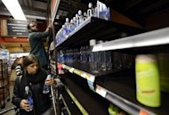 People try to get through the aisles at Whole Foods Market in Midtown in New York as residents do last minute food shopping in preparation for Hurricane Sandy