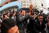 Ecuadorean President Rafael Correa (C) waves after voting a polling station in Quito on February 17, 2013. Correa declared victory in the first-round of Ecuador&#39;s presidential vote Sunday as he celebrated with thousands of supporters in the capital of the South American country