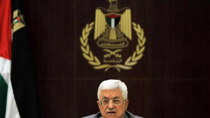 Palestinian president Mahmud Abbas addresses journalists in the West Bank city of Ramallah on July 13, 2014