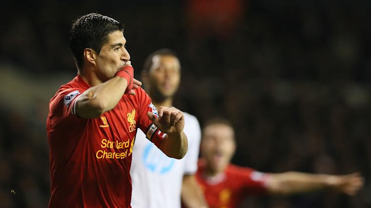 Suarez signs new contract with Liverpool
