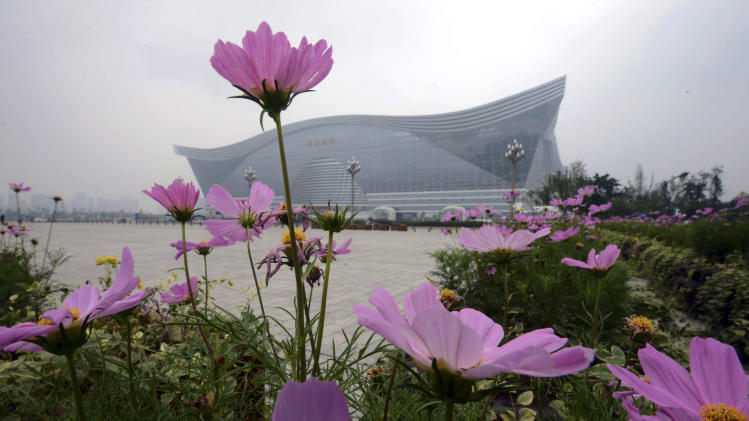 In this photo taken Monday July 8, 2013, the New Century Global Center, the world's largest single building, stands in the suburbs of Chengdu, in southwest China's Sichuan province. The world's largest building, in terms of floor space, has opened to the public in the booming Chinese city of Chengdu. (AP Photo) CHINA OUT