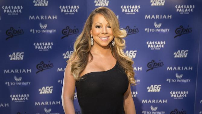 FILE - In this Monday, April 27, 2015, file photo, Mariah Carey poses for a photo at her Official Welcome to Caesars Palace in Las Vegas. Billboard and Dick Clark Productions announced Tuesday, May 5, 2015, that Carey will perform on this year's awards show. The 2015 Billboard Music Awards will be broadcast live from the MGM Grand Garden Arena in Las Vegas on Sunday, May 17. (Photo by Andrew Estey/Invision/AP, File)