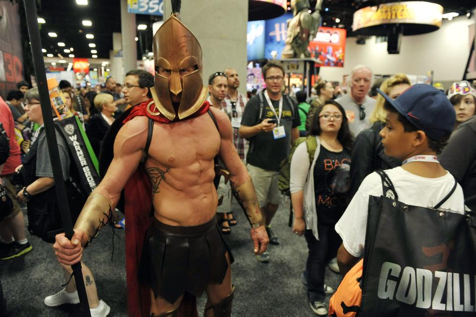 Dressed as a Trojan soldier, Todd Schmidt of San Diego, Calif., makes his way through the crowd during the Preview Night event on Day 1 of the 2013 Comic-Con International Convention on Wednesday, July 17, 2013 in San Diego, Calif. (Photo by Chris Pizzello/Invision/AP)