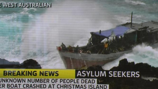 An asylum boat full of refugees being smashed by violent seas on the coast of Australia's Christmas Island in December 2010, this image is a Channel 7 screen grab from a photo released by The West Australian