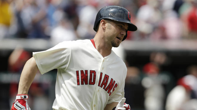 Cleveland Indians' Ryan Raburn runs the bases after hitting a three-run home run off Seattle Mariners starting pitcher Hisashi Iwakuma in the second inning of a baseball game, Monday, May 20, 2013, in Cleveland. Carlos Santana and Michael Brantley scored. (AP Photo/Tony Dejak)