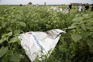 """A piece of a plane with the sign """"Malaysia Airlines""""…"""
