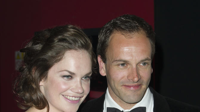 British actress, Ruth Wilson and British actor, Jonny Lee Miller pose with their awards for Best Actress and Actor at the Olivier Awards at the Royal Opera House, London,  Sunday, April 15, 2012. (AP Photo/Jonathan Short)