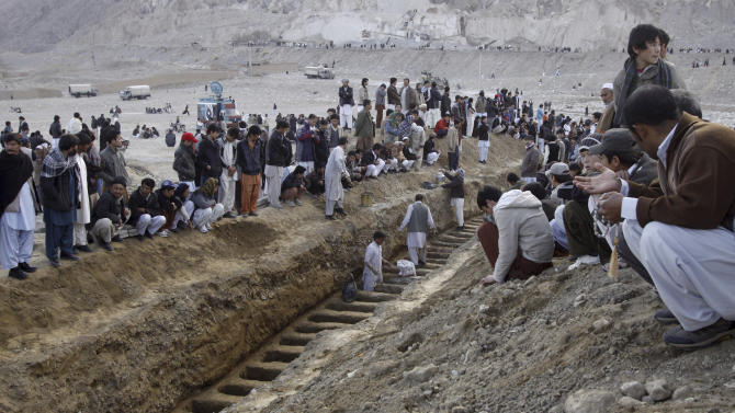 Pakistani men prepare the graves of Saturday's bombing victims in Quetta, Pakistan, Sunday, Feb. 17, 2013. Angry residents on Sunday demanded government protection from an onslaught of attacks against Shiite Muslims, a day after scores of people were killed in a massive bombing that a local official said was a sign that security agencies were too scared to do their jobs.  (AP Photo/Arshad Butt)