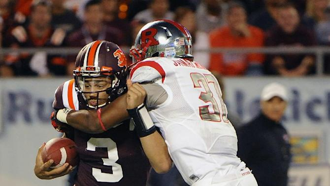 Virginia Tech quarterback Logan Thomas, left, is sacked for a loss of eight yards by Rutgers linebacker Jamal Merrell during the first quarter of an NCAA college football Russell Athletic Bowl game on Friday, Dec. 28, 2012, in Orlando, Fla. (AP Photo/Brian Blanco)