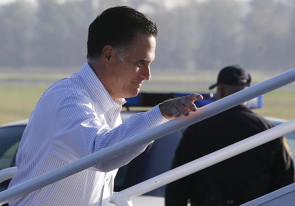 Republican presidential candidate, former Massachusetts Gov. Mitt Romney boards his campaign plane at Weyers Cave-Shenandoah Valley Airport in Weyers Cave, Va., Friday, Oct. 5, 2012. (AP Photo/Charles Dharapak)