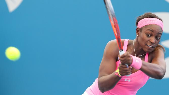 Sloane Stephens of the USA plays a shot in her 2nd round match against Sofia Arvidsson of Sweden during the Brisbane International tennis tournament in Brisbane, Australia, Wednesday, Jan 2, 2013.  (AP Photo/Tertius Pickard).