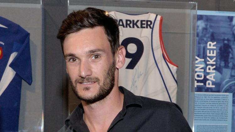 Goalkeeper of French soccer team Hugo Lloris, poses with his soccer jersey he worn during the 2014 World Cup match between France and Honduras, as he gives it to the National Museum of Sports in Nice