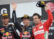 "Sebastian Vettel (C) celebrates on the podium with second-placed Mark Webber (L) and third-placed Fernando Alonso at the Korean Grand Prix awards ceremony on October 14. ""There are a hundred points up for grabs and everything will depend on how much we can improve over the coming races,"" Alonso said"