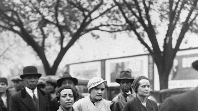 FILE - In this May 5, 1933 file photo, Ruby Bates, who reversed her previous testimony that she had been assaulted by nine black teenagers, center in light coat, marches in a parade of several hundred people through the Washington, D.C. streets to the White House, to present her petition for the liberation of the Scottsboro Boys. (AP Photo)