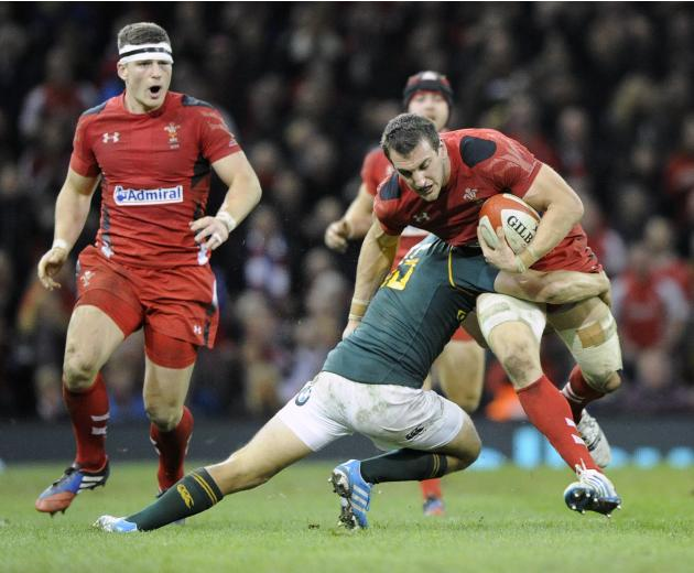 Wales' Sam Warburton is tackled by South Africa's Pat Lambie during the international rugby union match at the Millennium Stadium in Cardiff