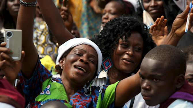 A crowd greets Pope Francis arriving to meet internally displaced people sheltered on the grounds of the Saint Sauveur church, during his visit in the capital Bangui