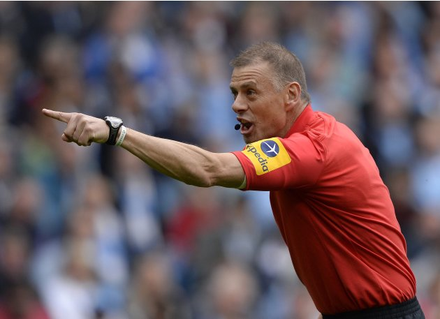 Referee Halsey gestures during the English Premier League soccer match between Manchester City and Norwich City in Manchester