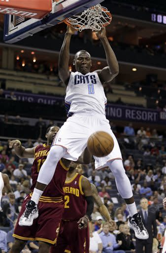 Walker's 24 points lift Bobcats over Cavs 105-98