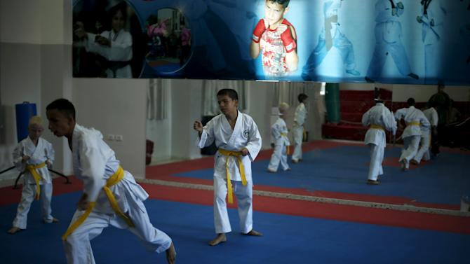 Blind and visually impaired Palestinian boys take part in a Karate class at al-Masthal club in Gaza city