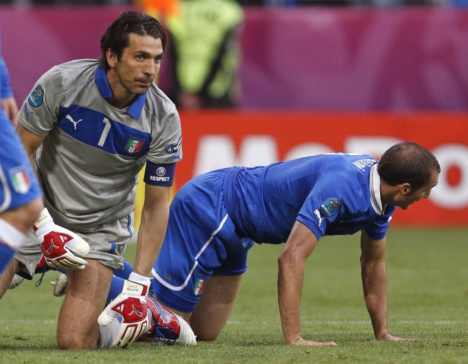 Italy goalkeeper Gianluigi Buffon, left, and defender Giorgio Chiellini react after Croatia's Mario Mandzukic scored a goal during the Euro 2012 soccer championship Group C match between Italy and Croatia in Poznan, Poland, Thursday, June 14, 2012. (AP Photo/Darko Bandic)