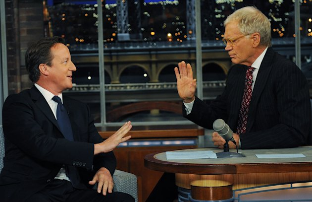 Britain&#39;s Prime Minister David Cameron (left) talks with talk show host David Letterman on the David Letterman Show after he addressed the United Nations General Assembly, in New York, Wednesday, Sept. 26, 2012. (AP Photo / Stefan Rousseau/PA) UNITED KINGDOM OUT: NO SALES: NO ARCHIVE: