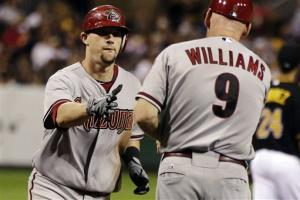 Johnson's homers lead D-Backs over Pirates