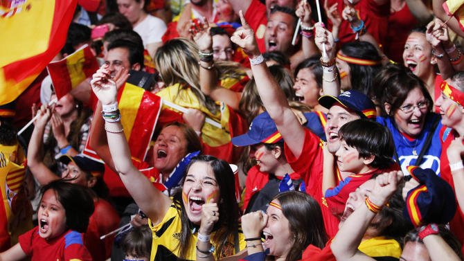 Spanish fans celebrate during the viewing of Euro 2012 soccer championship final match between Spain and Italy at the Fan Zone in Madrid, Spain, Sunday, July 1, 2012. (AP Photo/Andres Kudacki)