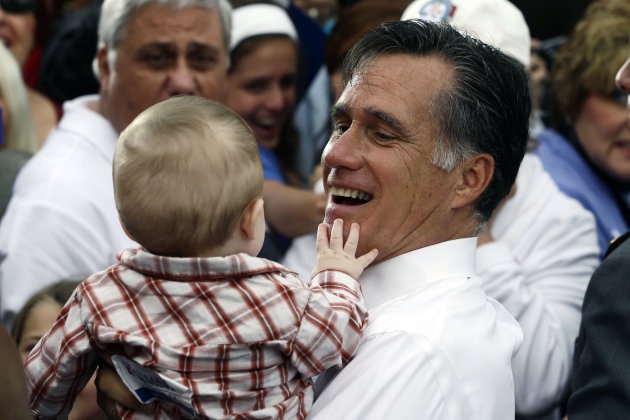 Republican presidential candidate and former Massachusetts Gov. Mitt Romney picks up a baby as he campaigns in front of The Golden Lamb Inn and Restaurant in Lebanon, Ohio, Saturday, Oct. 13, 2012. (A