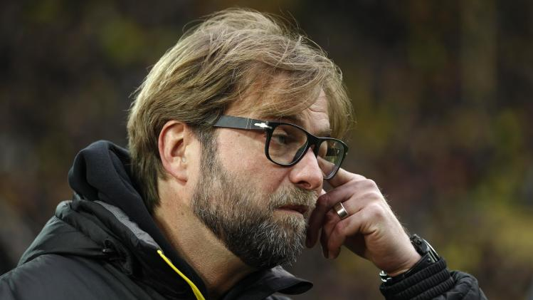 Borussia Dortmund's coach Klopp reacts before during the German first division Bundesliga soccer match against Hertha Berlin in Dortmund