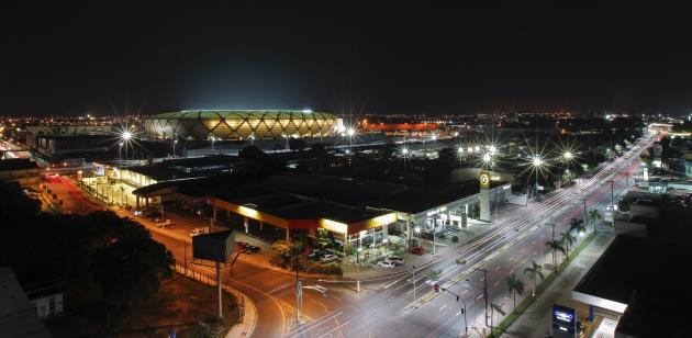A view of the Arena Amazonia stadium as its lights are tested in Manaus