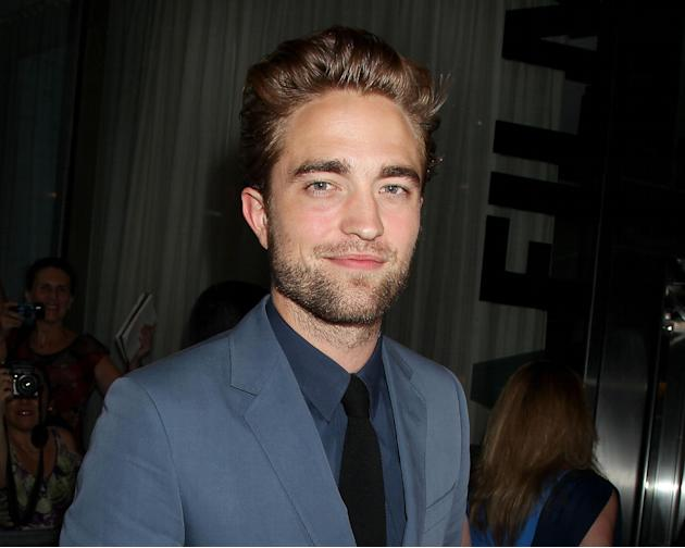 This Monday, Aug. 13, 2012 photo released by Starpix shows actor Robert Pattinson attending the premiere of