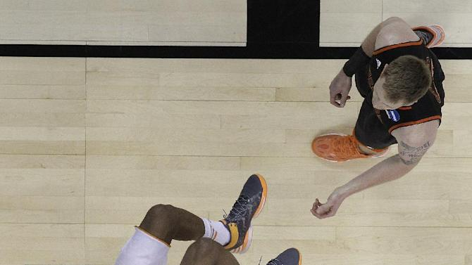 Tennessee guard Jordan McRae (52) dunks against Mercer forward Jakob Gollon (20) during the first half of an NCAA college basketball third-round tournament game, Sunday, March 23, 2014, in Raleigh