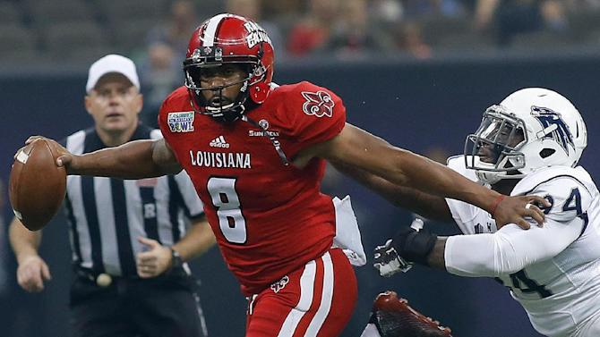 Louisiana-Lafayette quarterback Terrance Broadway (8) runs with Nevada defensive end Lenny Jones, right, in pursuit during the first half of the New Orleans Bowl NCAA college football game in New Orleans, Saturday, Dec. 20, 2014
