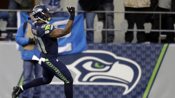 Seattle clinches No. 1 seed, beats Rams 20-6