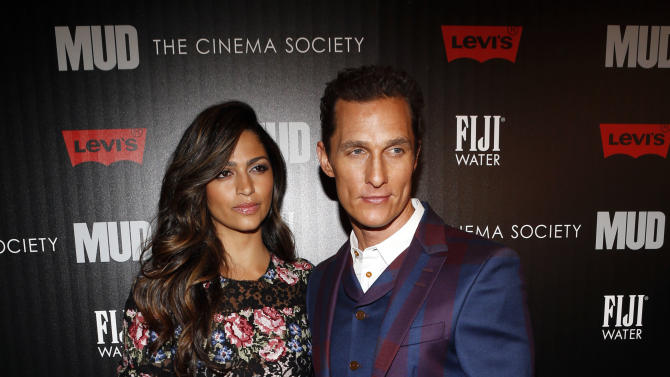 """Model Camila Alves and Matthew McConaughey arrive for The Cinema Society's screening of """"Mud"""" presented by FIJI Water, Sunday, April 21, 2013, in New York. (Photo by Jason DeCrow/Invision for FIJI Water/AP Images)"""