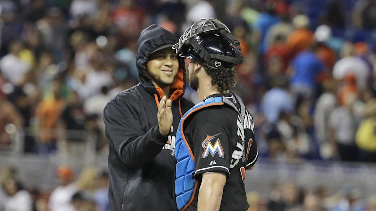 Miami Marlins starting pitcher Henderson Alvarez, left, shakes hands with catcher Jarrod Saltalamacchia, right, after the Marlins defeated the Washington Nationals 3-0 during a baseball game, Tuesday, July 29, 2014, in Miami. (AP Photo/Lynne Sladky)