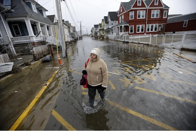 Carol Marelli walks down her flooded street Thursday, March 7, 2013, in Sea Bright, N.J., after an overnight storm. Flooding remained a problem in this and other shore towns. Water on roadways was als